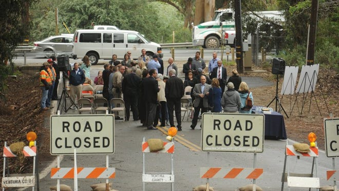 STAR FILE PHOTO Traffic whizzes by along Highway 118 as people gather for a 2016 ceremony on the old Donlon Road to mark the completion of the Donlon Road Realignment Project in Somis.