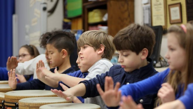 Students play instruments during music class at University of Memphis Campus School. The university is beginning to move toward opening a middle school.