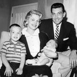 Charley Wolf and wife Loraine join their two boys, Martin, 2, and Stephen Joseph, one month.