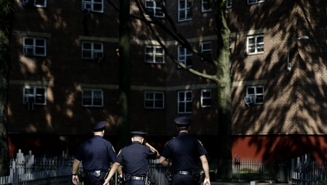 New York Police Department officers walk through the Brownsville Houses in Brooklyn, New York, on Aug. 13, 2013. A federal appeals court on Oct. 31, 2013, blocked a judge's order requiring changes to the NYPD's stop-and-frisk program and removed the judge from the case.