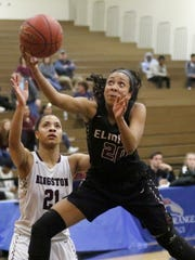 Zaria DeMember-Shazer of Elmira goes up for a scoop