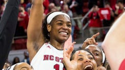 North Carolina State's Kiara Leslie (11) celebrates with her teammates following a victory in a second-round game in the NCAA women's college basketball tournament against Maryland in Raleigh, N.C., Sunday, March 18, 2018. North Carolina State defeated Maryland 74-60. (AP Photo/Ben McKeown)
