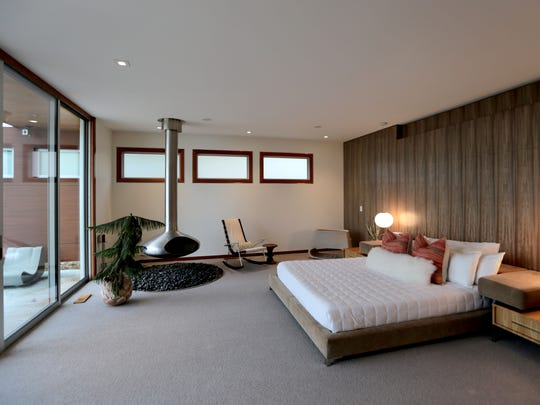 Master bedroom with floating fireplace and access to
