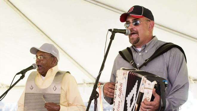 Horace Trahan, right, plays with his father-in-law, Rodney Bernard, during Rootstock 2013 at Beaver Park in Lafayette.