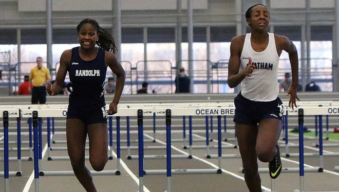 Randolph freshman Karen Hall (left) can't overtake Chatham senior Simone Kirton in the 55-meter hurdles during the Morris County Championships on Wednesday.