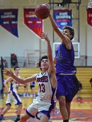Spanish Springs' Jalen Townsell blocks a shot by Reno's