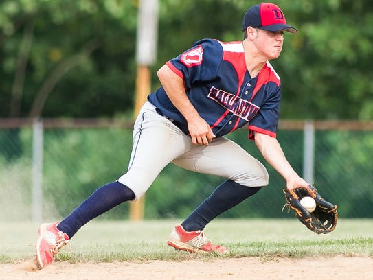 Dallastown's Jacob Gates fields a ball during the third