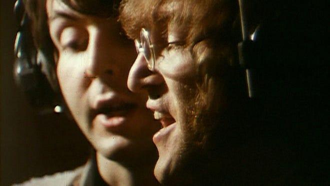 "Paul McCartney and John Lennon at Abbey Road Studios in 1968 recording ""Hey Bulldog."""