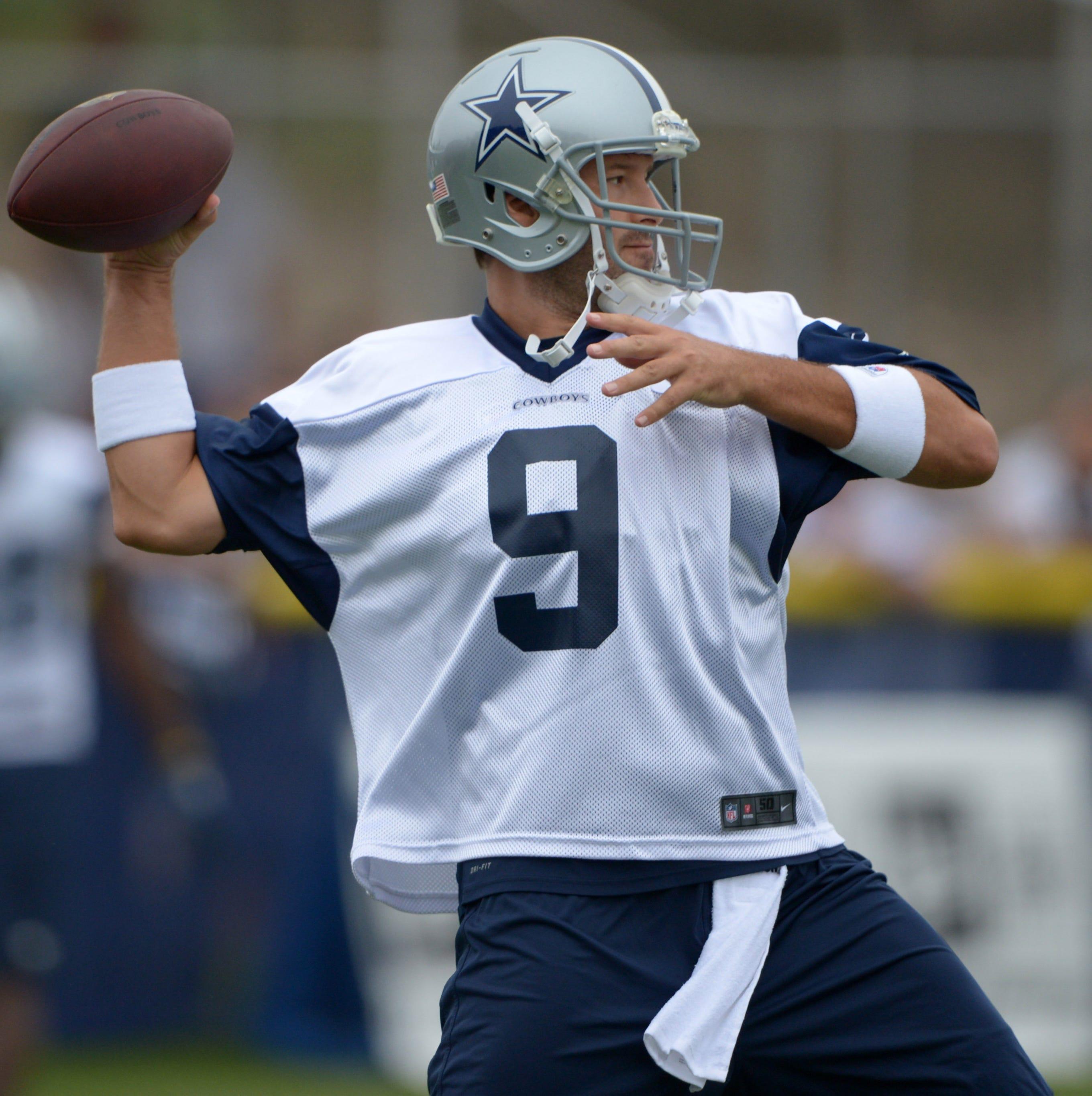 Dallas Cowboys quarterback Tony Romo throws a pass at training camp at the River Ridge Fields.