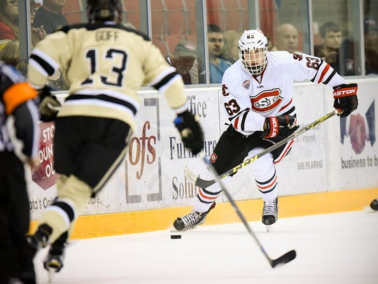 St. Cloud State's Patrick Russell (63) looks for a