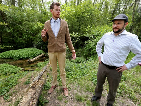 Connor Moss, left, and James Manning, right, show off Oaklands Park and wetlands. A tour will be given Sunday.