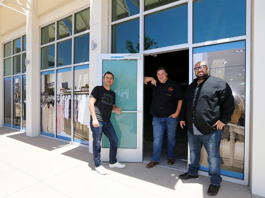 Octavio Gomez, Rudy Valdes and Nick Salgado owners of the three Crave Restaurants in El Paso stand at the entrance to what will be their newest location at the Fountains of Farah, which they expect to open during the fall of 2016.