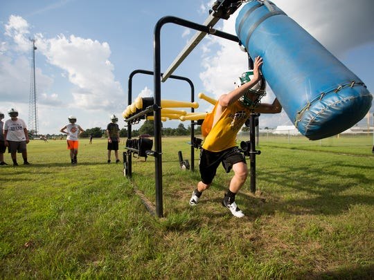 Freshman Gage Meddaugh works through drills during Almond-Bancroft football practice, Wednesday, Aug. 3, 2016.