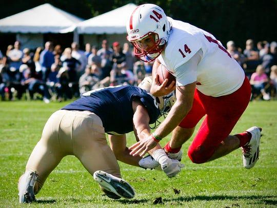 St. John's University quarterback Ben Alvord is brought