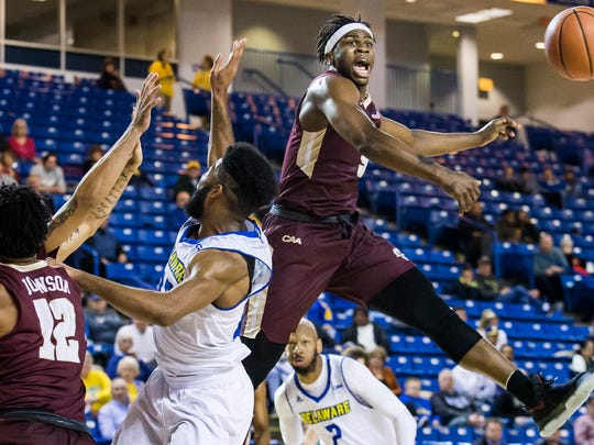 Charleston's Jarrell Brantley blocks a shot from Delaware's Cazmon Hayes in the second half of the University of Delaware's 65-56 loss to the College of Charleston at the Bob Carpenter Center in Newark on Monday night.