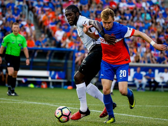 FC Cincinnati's Jimmy McLaughlin (20) takes the ball