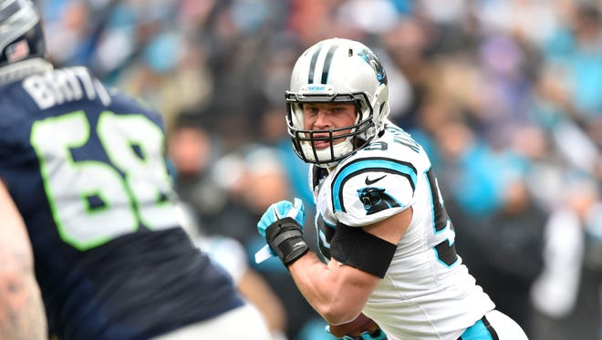 Jan 17, 2016: Carolina Panthers middle linebacker Luke Kuechly (59) returns an interception for a touchdown against the Seattle Seahawks in the first quarter of the NFC Divisional round playoff game at Bank of America Stadium.