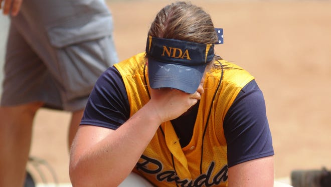 NDA senior Haylee Smith takes a moment after the end of her final game as a high school player.