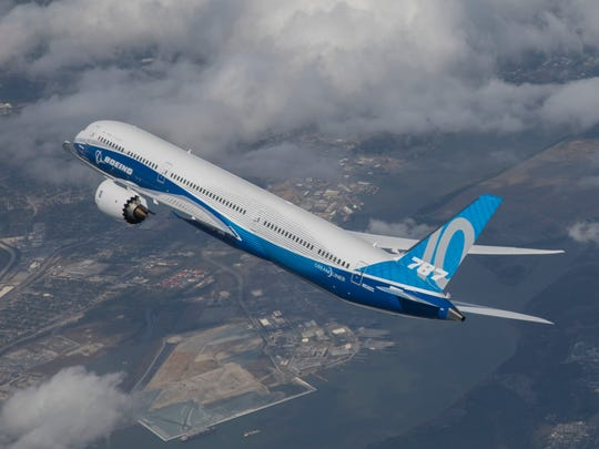 A Boeing Dreamliner in flight.