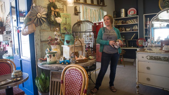 Sarah Herrera, an owner of Downtown Junkers, talks about the store's move to a new location on Thursday in downtown Farmington.
