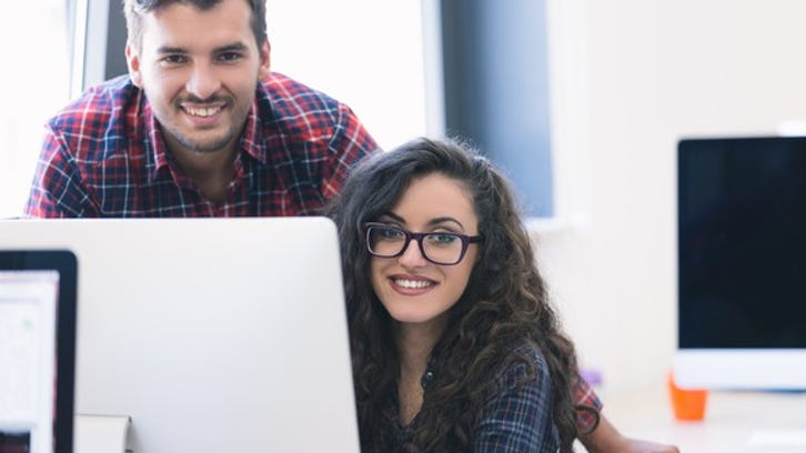 Younger couple working at a computer
