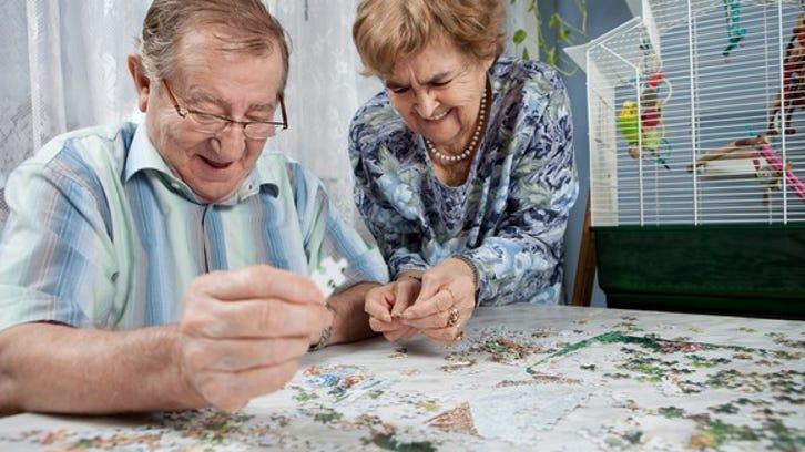 Senior couple doing a puzzle