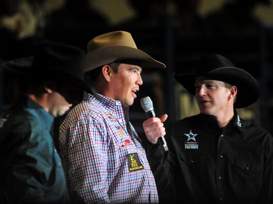 Dustin Bird, center, and his roping partner Chase Tryan