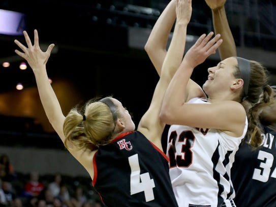 Ryle's Maddie Scherr (23) shoots over Holy Cross players