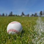 Baseball sitting in grass