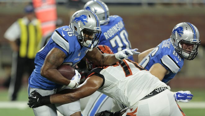 Lions rookie halfback Dwayne Washington carries against the Cincinnati Bengals during a preseason game at Ford Field in Detroit on Thursday August 18, 2016.