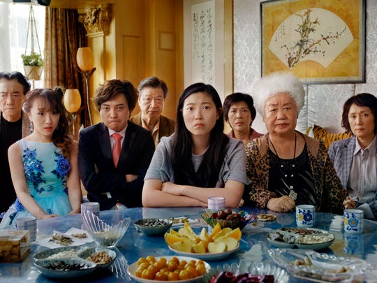 "Awkwafina, center, with the cast of ""The Farewell."""