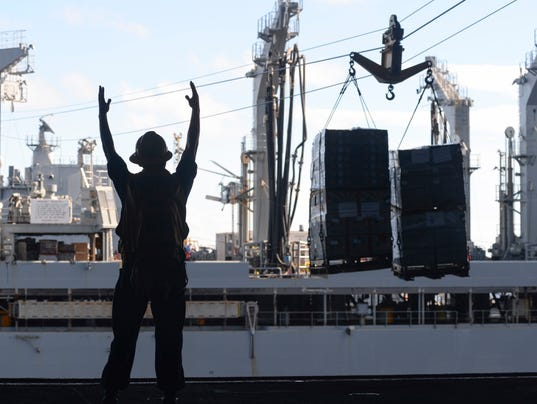 Sailors Signals To Crane Operator