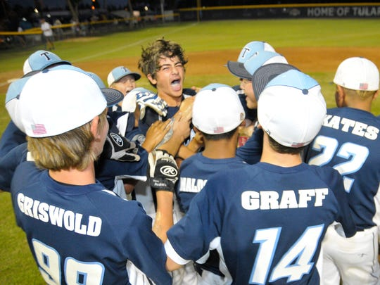 The Tulare Navy All-Stars celebrate after winning the Cal Ripken Major/60 Pacific Southwest Regional championship.