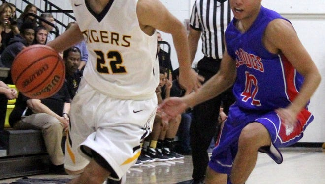 Abner Herrera turns the corner past Las Cruces' Daniel Guerrero on Friday night at the Tiger Pit.