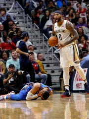 New Orleans Pelicans center DeMarcus Cousins (0) yells after elbowing Oklahoma City Thunder guard Russell Westbrook (0) in the head, drawing an ejection from the game, in the second half of an NBA basketball game in New Orleans, Monday, Nov. 20, 2017. (AP Photo/Scott Threlkeld)