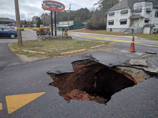 The sinkhole in front of Moe's Original Bar B Que in