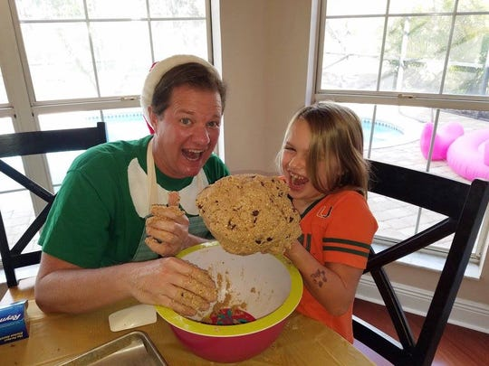 My sister's daughter Khloe taking over the cookie ball tradition.