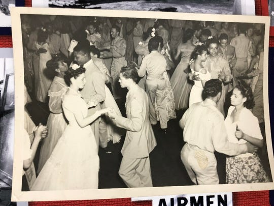 Walter Manning, pictured in the upper right-hand corner, dancing with girlfriend (Dicey) Thomas, who is in an all-white dress. Circa 1944.
