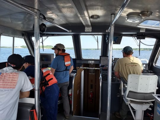 The survey team is configuring a multibeam echo sounder