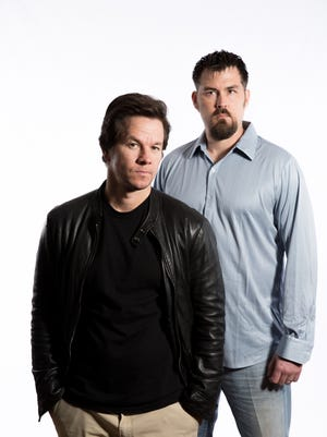 """Actor Mark Wahlberg, left, and Marcus Luttrell, a former Navy SEAL, pose together in New York City at the Mandarin Oriental Hotel on Dec. 5, 2013. In """"Lone Survivor,""""  Wahlberg portrays Luttrell, who survived a botched mission deep in Afghanistan, sustaining horrific injuries and now suffering from post-traumatic stress disorder."""