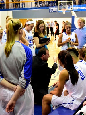 Thomas More coach Jeff Hans spends a timeout to help the Lady Saints regroup, March 11, 2016.