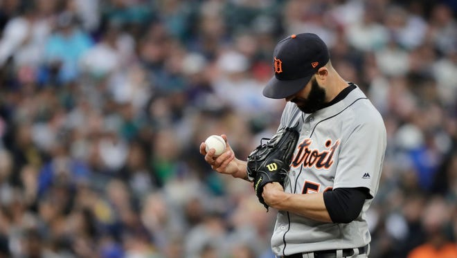 Detroit Tigers starting pitcher Mike Fiers holds the ball on the mound after he gave up a solo home run to Seattle Mariners' Jean Segura during the first inning on Saturday