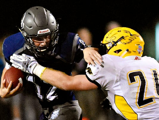 Red Lion's Patrick Daugherty, right, moves in to take down Dallastown's Michael Sparks, left, during high school football action in Dallastown, Pa. on Friday, Nov. 6, 2015. Red Lion would win the game 26-0. Dawn J. Sagert - dsagert@yorkdispatch.com