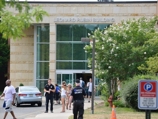 Security guards at the JCC in Tenafly stand outside the Leonard Rubin Building on Thursday, July 28, 2016.