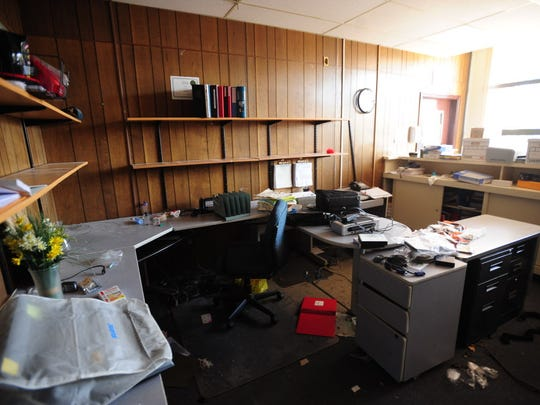 In this Nov. 9, 2012 file photo, Moonachie Borough Hall is damaged by Superstorm Sandy.