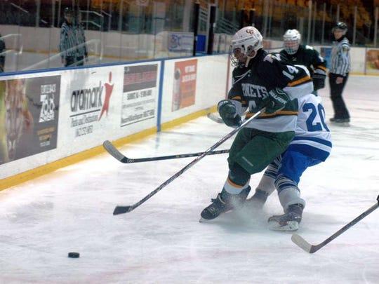 Senior center Joe Kubu (14), shown in a previous season's game, had a goal and an assist to help the Passaic Valley/Cedar Grove hockey team defeat Paramus/Lyndhurst/Hackensack on Friday.