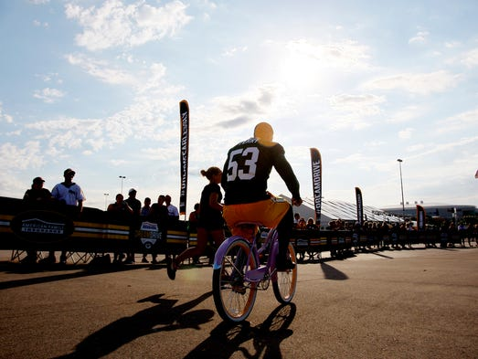 Nick Perry rides a bike during the second day of Green