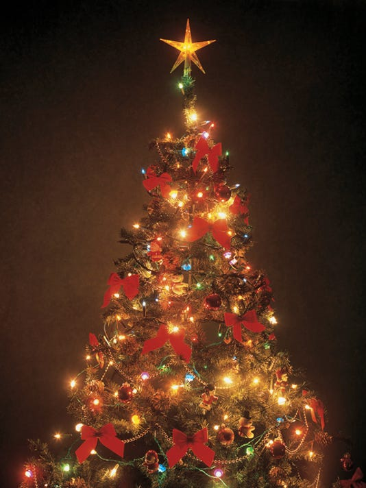 close-up of a decorated and lit up Christmas tree