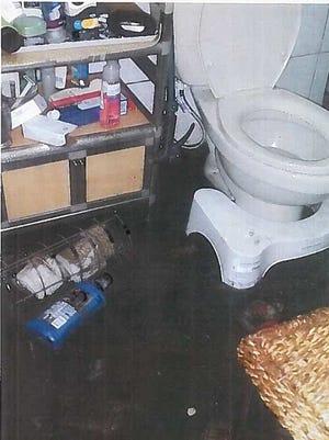 Talofofo home damaged by sewage overflow.