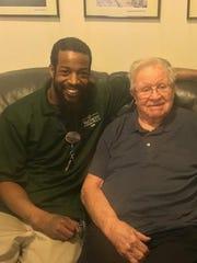 Waltonwood Cherry Hill caregiver Eric Gross (left)
